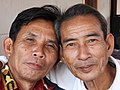 Two old men hugging in Laos.jpg