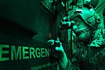 U.S. Air Force Senior Airman Larry Webster, a loadmaster with the 774th Expeditionary Airlift Squadron, scans for threats using night vision goggles aboard a C-130H Hercules aircraft after completing a cargo 131007-F-YL744-119.jpg