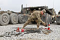 U.S. Army Spc. Lyle Carter, a wheeled vehicle driver with the 396th Transportation Company, 157th Combat Sustainment Support Battalion, Task Force Durable, organizes equipment while taking inventory for 130214-A-FS017-001.jpg