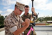 U.S. Marine Corps Lance Cpl. Edwards, left, a geospatial intelligence analyst with the 2nd Intelligence Battalion, II Marine Expeditionary Force, demonstrates the use of the Topcon GR-3 global navigation 140913-M-PZ610-758.jpg