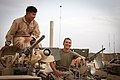 U.S. Marine Corps Lance Cpl. Phillip Lim, left, and Cpl. Brandon Baber, both assigned to Delta Company, 1st Tank Battalion, Regimental Combat Team 7, take a break while conducting function checks on an M1A1 130425-M-RO295-102.jpg