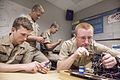 U.S. Naval Academy Midshipmen Aaron Fleming, Kyle Hawkins, Ethan Genco and Victor Bowen work inside the Naval Postgraduate School's Cyber Academic Group Lab as part of an internship in Monterey, Calif., June 13 130613-D-AE587-001.jpg