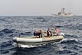 U.S. Sailors with the guided missile frigate USS Simpson (FFG 56) drive a rigid hull inflatable boat alongside a fishing vessel in Senegal's exclusive economic zone after dropping off a joint boarding team 120623-N-GN377-143.jpg
