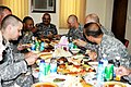 U.S. Soldiers eat a meal with Iraqi police Maj. Gen. Emad Faris, background, center, commander, 1st Iraqi Federal Police Division, following a meeting at Joint Security Station Loyalty in Baghdad, Iraq, July 12 110712-A-QL809-003.jpg