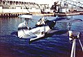 USCG J2F-6 Duck is hoisted abaord a ship 1946.jpg