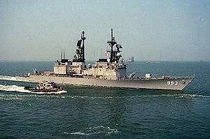 USS Kidd (DDG-993) underway with tug in 1990.jpg