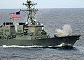 US Navy 030520-N-0295M-010 The Arleigh Burke-class destroyer USS Milius (DDG 69) fires its 54-caliber (Mk 45) lightweight gun.jpg