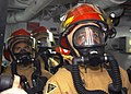 US Navy 031014-N-8955H-002 Damage Control Repair Locker One Alpha fire hose team stands ready to fight a simulated Class Bravo fire in an engine room.jpg