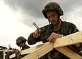 US Navy 041027-N-5526M-006 Seabees assigned to Naval Mobile Construction Battalion One (NMCB-1), assemble a wood frame for a command and control headquarters during Operation Gulf Mist at Camp Shelby, Miss.jpg