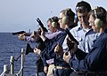 US Navy 041119-N-5837R-131 Crew members participate in a small arms qualifications on the fantail of the Nimitz-class aircraft carrier USS Abraham Lincoln (CVN 72).jpg