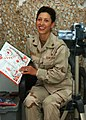 US Navy 041209-N-4338F-009 Construction Mechanic 2nd Class Dawn Ayala, assigned to Naval Mobile Construction Battalion Four (NMCB-4), reads a copy of How the Grinch Stole Christmas.jpg