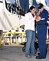 US Navy 050201-N-7397A-042 Damage Controlman 3rd Class Bryan Crews assigned to the guided missile destroyer USS Mustin (DDG 89) says goodbye to his family at 32nd Street Naval Station San Diego, Calif.jpg