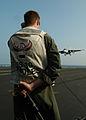 US Navy 050217-N-8704K-002 A Landing Signal Officer (LSO) signals a clear deck.jpg