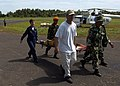 US Navy 050411-N-1485H-005 Ens. Mat Nolan, front center, and Cmdr. Karen McDonald, back left, help unload patients that have been medically evacuated.jpg
