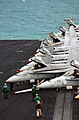US Navy 051113-N-7241L-005 F-A-18C Hornets are staged on the bow prior to flight operations aboard the Nimitz-class aircraft carrier USS Theodore Roosevelt (CVN 71).jpg