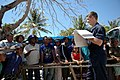 US Navy 060825-N-3714J-061 Navy Religious Programs Specialist 3rd Class Steven Kennan of Auburn, Calif., attached to the Military Seallfit Command hospital ship USNS Mercy (T-AH 19), shows flash cards to local residents to help.jpg