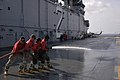 US Navy 061130-N-4207M-021 Members of the amphibious assault ship USS Essex (LHD 2) air department crash and salvage team clean the ship's flight deck on the transit back to Sasebo.jpg