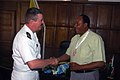 US Navy 071019-N-4014G-380 Cmdr. Robert Hall Jr., commanding officer of guided-missile destroyer USS Porter (DDG 78), presents a command coin to the Mayor of Mombassa, Kenya, Hamisi Mwindani.jpg