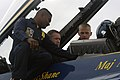 US Navy 071031-N-8102J-019 Brian Schneider, catcher for the Washington Nationals baseball team, receives preflight instructions from the crew chief, Marine Corps Staff Sgt. Deo Harrypersaud, before taking a ride in a Blue Angel.jpg