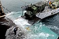 US Navy 071115-N-6936D-085 Sailors from amphibious transport dock ship USS Juneau (LPD 10) perform a stern gate mairige with a landing craft utility to off load two, seven-ton trucks from Juneau.jpg