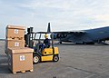 US Navy 071124-N-5677B-004 Aviation Maintenance Technician 1st Class Kenny Icsik prepares to load boxes of Project Handclasp donations aboard an Air Force C-17 at Cecil Field airport.jpg