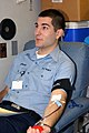 US Navy 071219-N-1981M-069 viation Ordnanceman Airman Apprentice Chris J. Cusumano, of the Precommissioning Unit (PCU) George H.W. Bush (CVN 77), donates blood during the command's first blood drive.jpg
