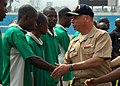 US Navy 080201-N-0577G-006 Capt. John Nowell, commander of Africa Partnership Station (APS), wishes members of the local Equatorial Guinea soccer team good luck before a match against the team from the amphibious dock landing s.jpg