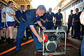 US Navy 080603-N-8613A-108 Midshipmen embarked aboard the amphibious dock landing ship USS Ashland (LSD 48) practice starting a P-100 pump used for firefighting and dewatering.jpg