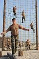 US Navy 080715-N-2959L-083 Seaman Kristopher Linton concentrates on keeping his balance while participating in an obstacle course.jpg