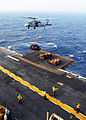 US Navy 080831-N-2183K-043 An MH-60S Sea Hawk helicopter delivers crates of supplies to the amphibious assault ship USS Peleliu (LHA 5) during a vertical replenishment at sea.jpg
