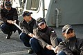 US Navy 081001-N-1706T-002 Fire Controlman 3rd Class Brandon Roehl Sonar Technician (Surface) 3rd Class Brian McKeon, Sonar Technician (Surface) 3rd Class Jesse Lindsey and Sonar Technician (Surface) Manoj Sewal pull a mooring.jpg