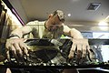 US Navy 081030-N-4995K-061 Damage Controlman Fireman Brett Malon, assigned to the aircraft carrier USS Ronald Reagan (CVN 76) rests his hands in a fish tank of doctor fish during a spa treatment.jpg