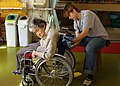 US Navy 090302-N-3241S-011 Electrician's Mate 1st Class Kellie Matzen cleans a resident's wheelchair.jpg