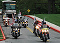 US Navy 090429-N-8936G-002 The Patriot Guard Riders, a group of motorcycle-riding volunteer citizens dedicated to honoring and supporting American service members, escorts the motorcade of Individual Augmentees (IA) to a welcom.jpg