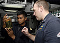 US Navy 091206-N-9520G-028 Lt. Jake Faulds shows a sample of F76 fuel to Lt. Yusri of the Royal Malaysian Navy.jpg