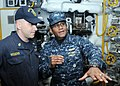 US Navy 100302-N-6764G-080 Vice Adm. Mel Williams Jr., commander of U.S. 2nd Fleet, asks Chief Machinist's Mate Hurdis Rogers about the engineering spaces aboard the amphibious assault ship USS Kearsarge (LHD 3).jpg