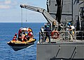 US Navy 100711-N-3446M-178 Merchant mariners assigned to the Military Sealift Command dry cargo and ammunition ship USNS Amelia Earhart (T-AKE 6) hoist a lifeboat and crew from the targets department of Commander Fleet Activiti.jpg