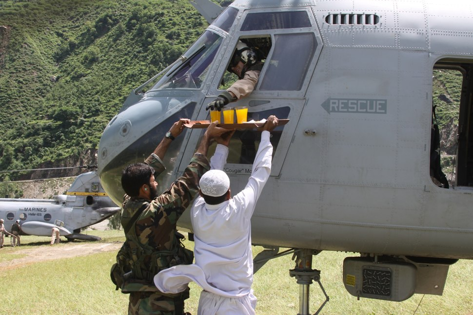 US Navy 100827-M-3497D-145 A Pakistani man offers fruit juice and cookies to Marines during humanitarian relief efforts in Khyber- Pakhtunkhwa Province, Pakistan
