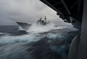US Navy 111224-N-DR144-439 USS Bunker Hill pulls away after taking on fuel in heavy seas.jpg