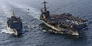 US Navy 120105-N-OY799-347 The Nimitz-class aircraft carrier USS John C. Stennis (CVN 74) is underway alongside the Military Sealift Command fast c.jpg
