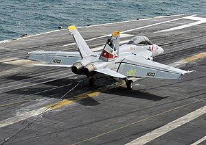 US Navy 120209-N-YB753-103 An F-A-18F Super Hornet assigned to the Bounty Hunters of Strike Fighter Squadron (VFA) 2 traps an arresting wire on the.jpg