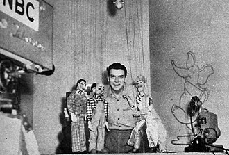 Howdy Doody - On the air with the first Howdy Doody puppet.  The original Howdy is immediately to Smith's left. The two other puppets are Mr. Huff and Eustis who appeared only for a short time on a Saturday edition of the Puppet Playhouse show.