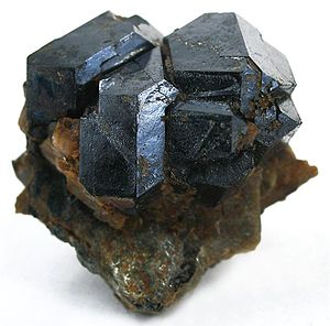 Uraninite - Uraninite crystals from Topsham, Maine (size: 2.7×2.4×1.4 cm)