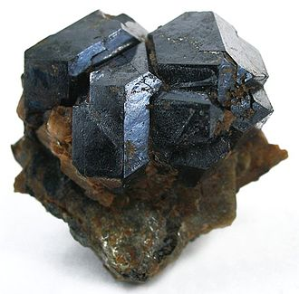 Uraninite - Uraninite crystals from Topsham, Maine (size: 2.7 × 2.4 × 1.4 cm)