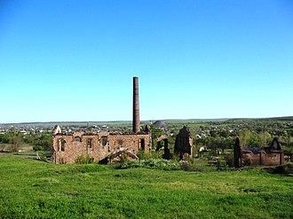 Uspenka - Ruins of a former coke works, with Uspenka behind it.