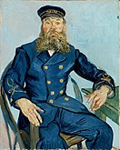 A portrait of a middle aged man with a mustache and beard seated on a chair facing to his left (the viewer's right). He has a thoughtful look on his face and his hands are free while his left arm rests on a table, he is wearing a dark blue uniform and cap, in front of a pale blue background.