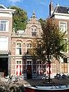 foto van Voormalig bankgebouw van de Rijnlandsche Bankvereeniging, naderhand in gebruik als winkelwoonhuis bij Papierhandel Paddenburg verpakkingsmaterialen
