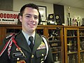 WWJROTC Commander Jeremy Bordens guards Heisman Trophies.JPG