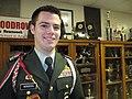 WWJROTC Commander Jeremy Bordens guards Heisman Trophies.JPG