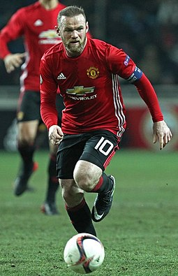 Wayne Rooney, shown wearing the number 10 shirt, was used by Alex Ferguson as a second striker on many occasions during their time together at Manchester United, playing behind the number 9. Wayne Rooney 144855.jpg